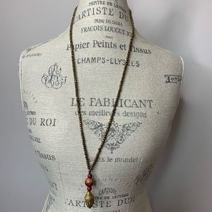 Gold colored necklace with 3 stones